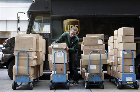 ups packages shipping delivery package amazon christmas holiday delivered truck driver air deliveries york says fedex volume refunds misses business