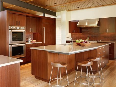To match with the overall kitchen look, this kitchen island uses dark wooden materials as the stand. 29 Creative Kitchen Island with Table Extension Designs at Kutsko Kitchen