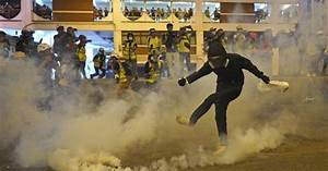 Police launch tear gas, masked assailants attack ...