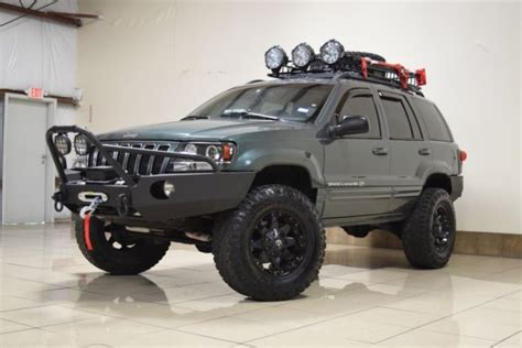 jeep grand cherokee modified custom jeep grand cherokee overland 4x4 lifted tv dvd navi