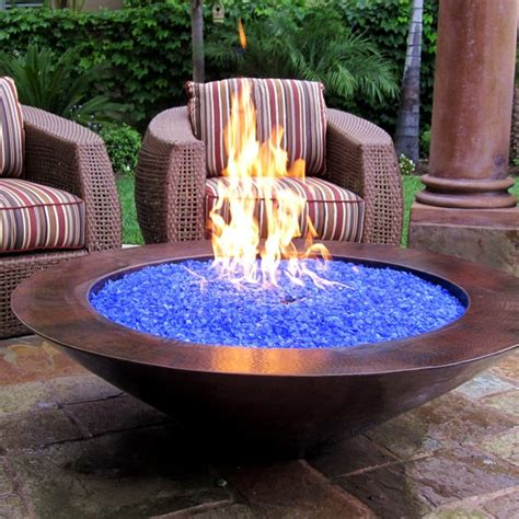 The burner system produces a wide range of heat output peaking at 90,000 btus. What is Fire Glass and How Does it Work? I Portable Fireplace