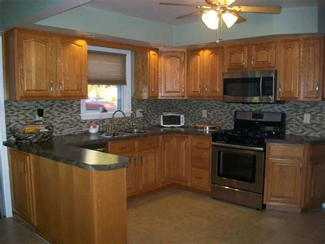 oak kitchen cabinets and wall color count them reasons why you should buy oak kitchen 8966