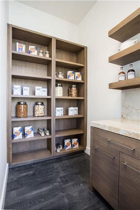gorgeous kitchen pantry boasts walnut stained cabinets
