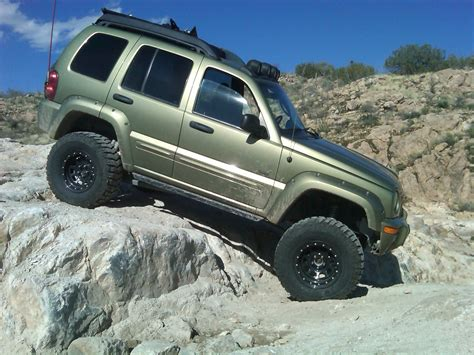 stanced jeep liberty 100 gold jeep liberty all things jeep jeep wrangler