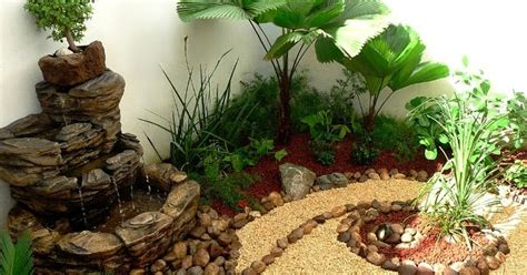 diseno de  jardin muy pequeno  fuente piedras
