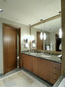Pendant lights over vanity with chunky mirror design