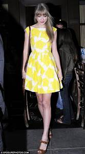 Taylor Swift brightens up her night with sunshine yellow ...
