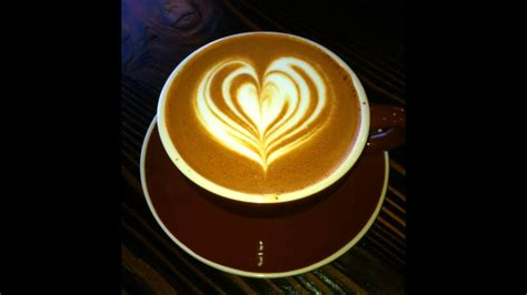 Holding coffee latte with cozy hand warmers on magic background. Latte Art Heart: Pour in a Cafe Latte Mug w/ Espresso + Steamed Milk Latte Art by Donny Morrison ...