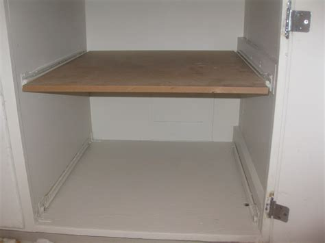 Pull Out Cupboard by Diy Pull Out Cupboard Drawers Creatively Living