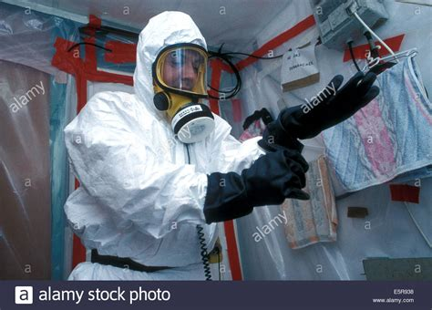 worker putting   protection suit  working