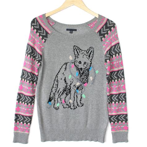 husky puppy tangled in lights sweater