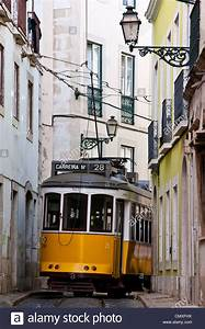 Electrico Tram 28 Passing Through A Narrow Street In Alfama District Stock Photo  Royalty Free