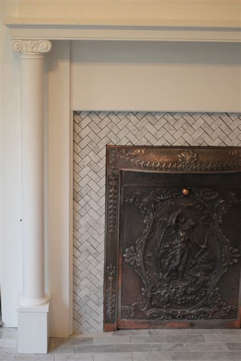 the herringbone marble tile fireplace