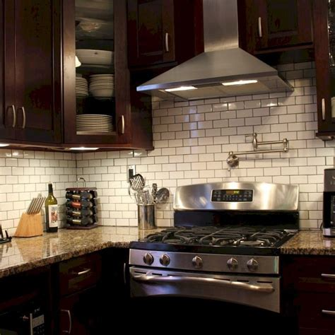Be sure to add some under cabinet lighting to highlight the wood. 85 Gorgeous Kitchen Backsplash Decor with Dark Cabinets ...