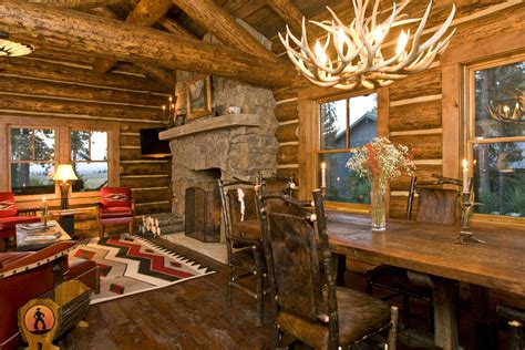 small cabin ideas living room rustic with stone fireplace stone mantel fire screen czmcam org