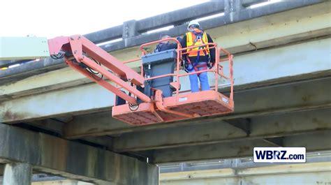 raised bed dump truck hits intracoastal bridge  la