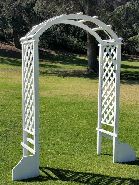 white wood garden arch    amigo party rentals
