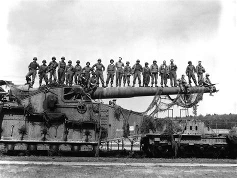 soldiers on top of german railway gun the