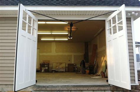 swing out garage doors clingerman doors custom wood garage doors clearville pa