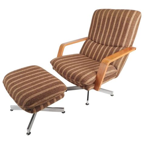mid century modern teak and chrome swivel lounge chair