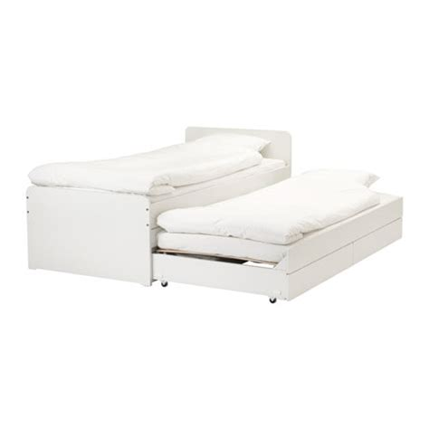 SLÄKT Bed frame w/pull out bed + storage IKEA