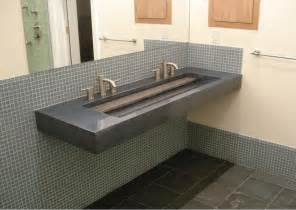 beautiful small trough bathroom sink with two faucets
