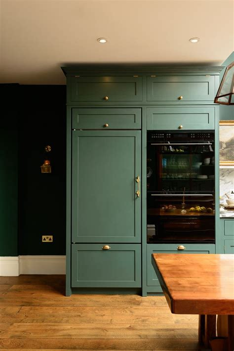 green kitchen cabinets with black appliances 17 best ideas about green cabinets on green