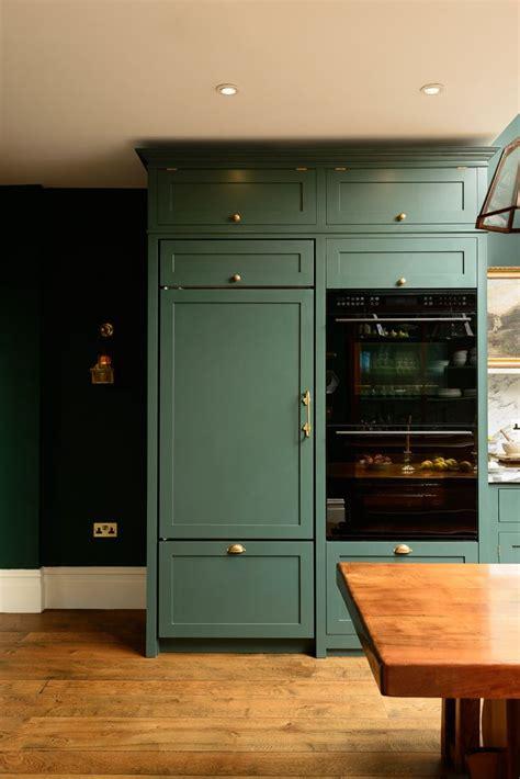 integrated appliances  beautiful bespoke dark green