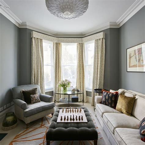 Living Room Window Podcast by Grey Living Room With Bay Window And Floor Length Curtains