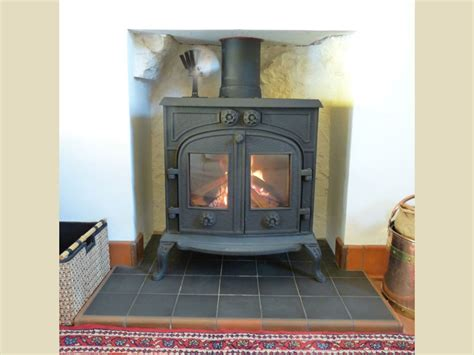 petit godin wood stove  custom fireplace quality