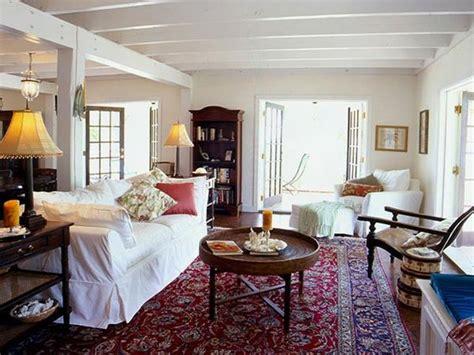 living room white slipcovered sofa oriental rug wood