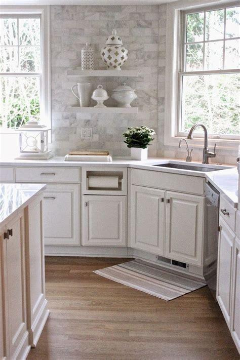 white quartz countertops   backsplash  carrera