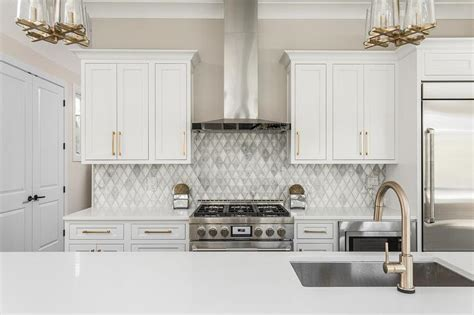 White and Gold Kitchen with Long Brushed Brass Pulls