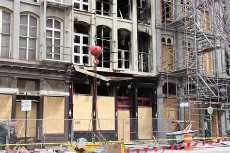 demolition begins   city buildings gutted  fire whyy