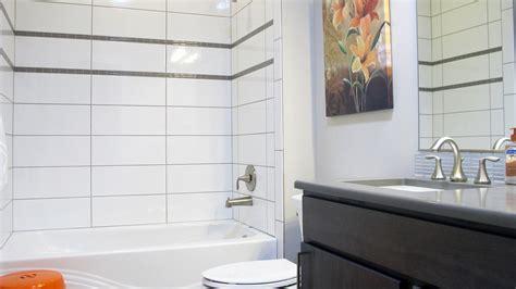 subway tile mosaic backsplash gray countertop white cabinets grey bathroom floor tiles