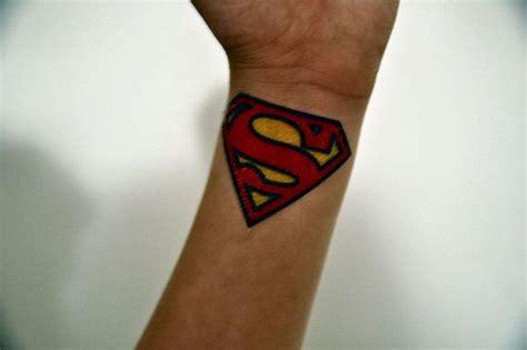 graceful superman wrist tattoos