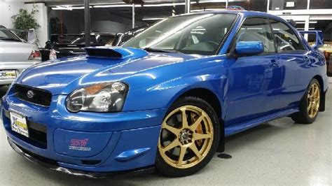 blue subaru gold rims 2004 subaru impreza wrx sti super clean rare wr blue
