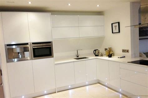 white gloss kitchen  white quartz worktop google