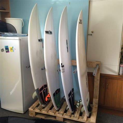 how to make a surfboard rack for your how to store surfboards paddle boards and cruisers