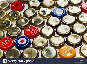 Crown beer bottle caps, some printed with brand names ...