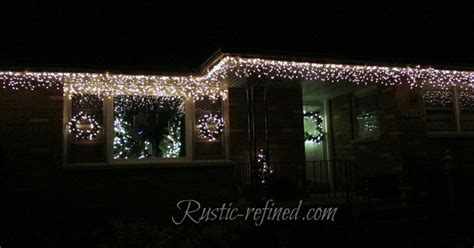 hanging christmas lights on windows outside hang outdoor holiday lights quickly tutorial hometalk