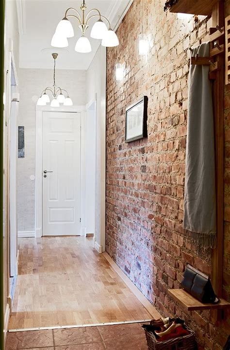 entry way idea for the brick walls need to add more lights above to brighten the in the