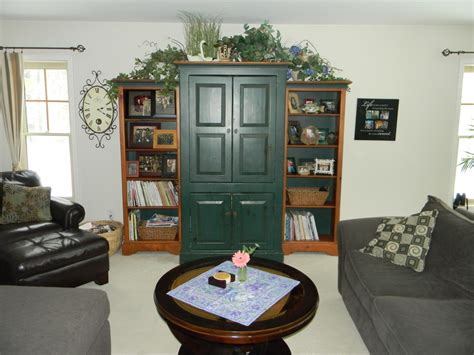 Decorating Ideas Top Of Armoire by Decorating Above Tv Armoire Joyful