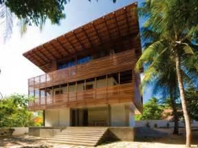 wooden  storey tropical house design  ideas