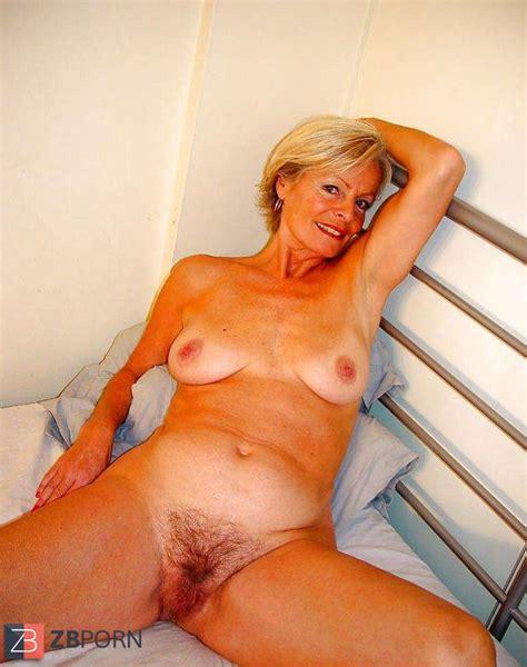 Justine A Mature Platinum Blonde Posing On A Sofa Zb Porn