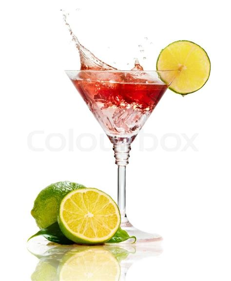red martini red martini cocktail with splash and lime isolated on