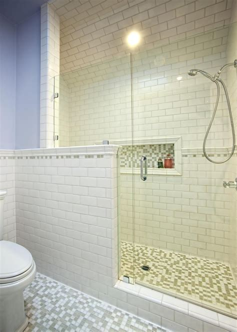 Subway Tiles In Bathroom by White Subway Tile Sheathes The Wall And Shower In This