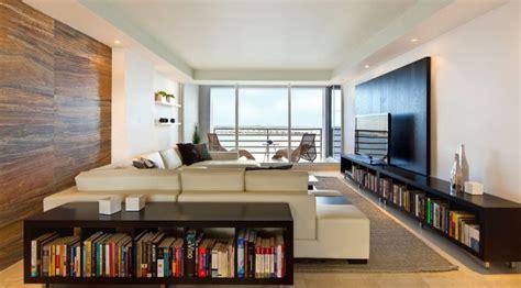 long living room ideas  wide tv   bookshelves