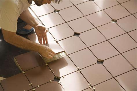 Bathroom Floor Tile Installation by Bathroom Vinyl Tile Vs Ceramic Tile