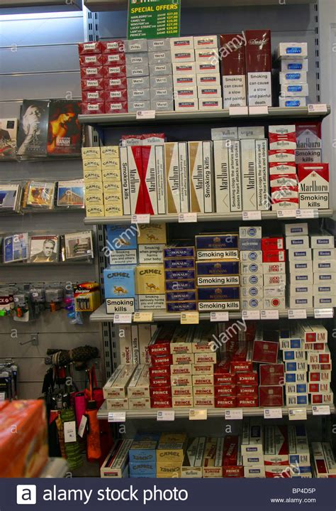 where to buy cheap shelves tobacco cigarettes in duty free shop shopping stock photo